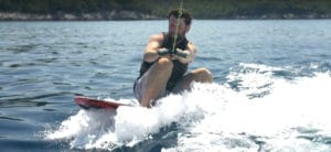 how to surf behind a boat